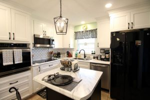 Bright white cabinets with complimentary black and stainless steel appliances
